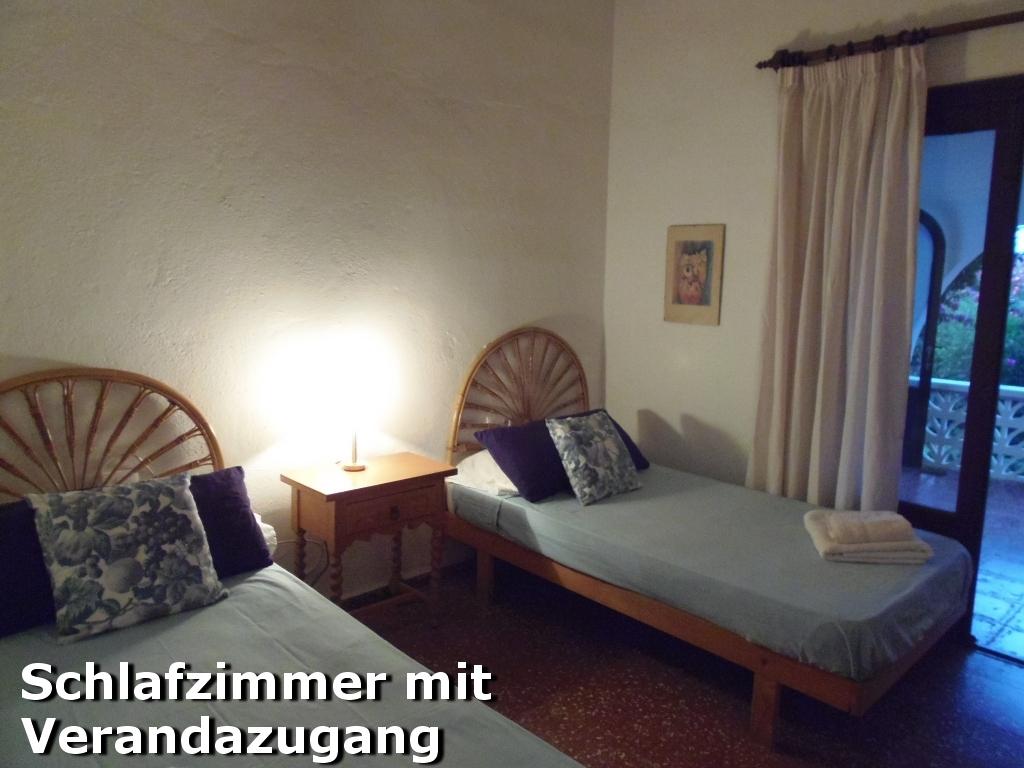 Zweites Schlafzimmer mit Verandazugang